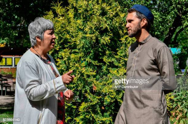 Openly gay French imam LudovicMohamed Zahed and GermanTurkish lawyer author and activist Seyran Ates chat prior to Friday prayers at the Ibn...