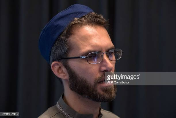 Openly gay French imam LudovicMohamed Zahed speaks to a journalist prior to Friday prayers at the Ibn RushdGoethemosque in Berlin on July 28 2017...