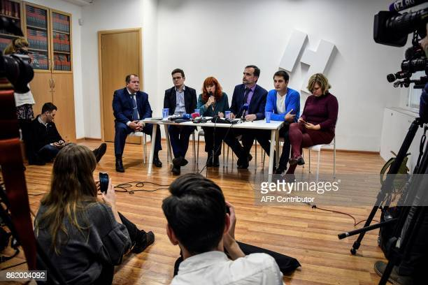 Openly gay Maxim Lapunov along with human rights and gay rights activists attend a press conference in Moscow on October 16 2017 A gay man living in...