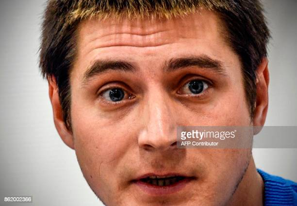 Openly gay Maxim Lapunov gives a press conference in Moscow on October 16 2017 A gay man living in Chechnya on October 16 2017 went public to...