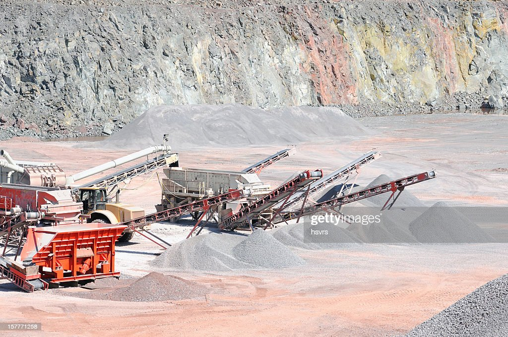 Open-pit Mine Quarry with conveyor belts crushing stones