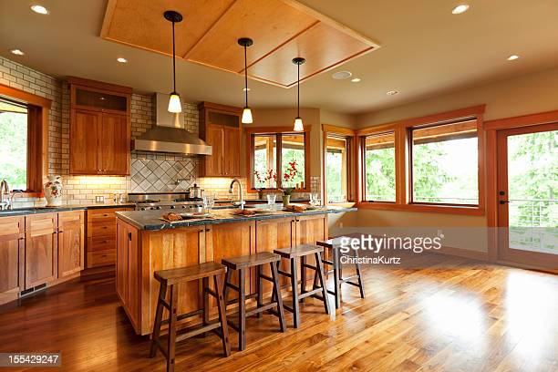 Open-plan kitchen with wooden cabinets and walnut floor