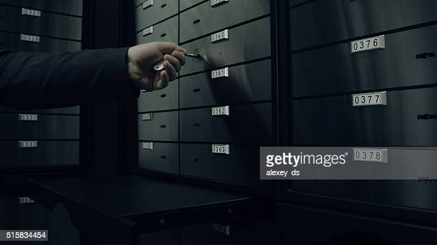 Opens one of safety deposit box