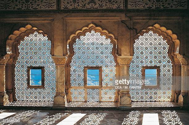 Openwork windows in the Mandir Jess hall Amber Fort or Amer Palace Jaipur Rajasthan India