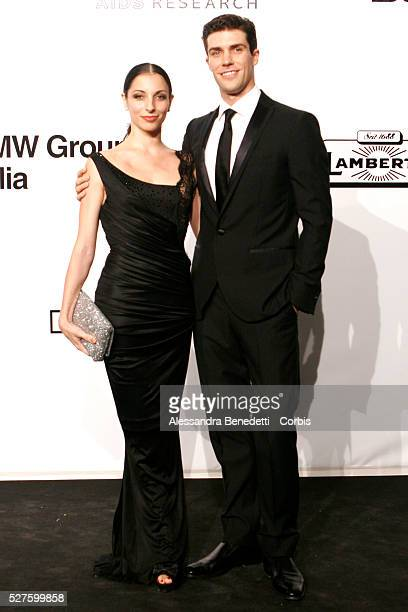 Opera ballet dancer Roberto Bolle and guest on the AmfAR Milano 2009 red carpet during the inaugural Milan Fashion Week event at La Permanente