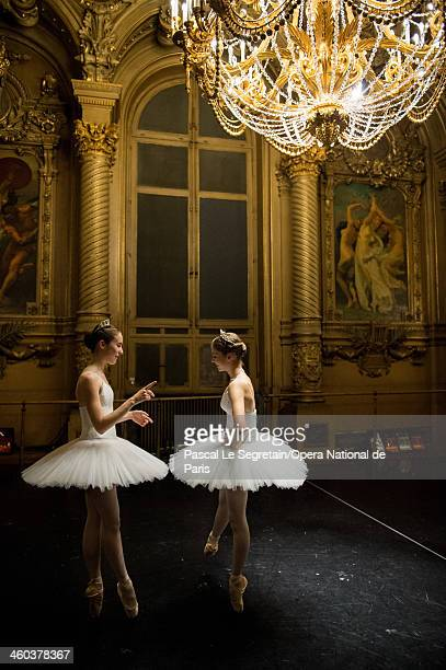 Opera Ballet School pupils stand in the Oepra Garnier foyer before a rehersal for the 'Generale' performance at Opera Garnier on April 12 2013 in...