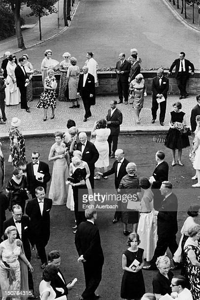 Opera enthusiasts during the interval at the Bayreuth Festival in Germany 27th July 1963 At the top left holding a fan is the Begum Om Habibeh Aga...