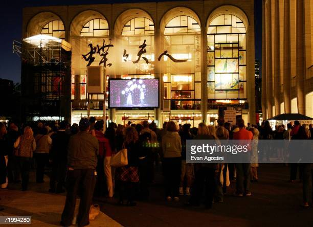 Opera fans watch 'Madama Butterfly' on an outdoor television screen during the Metropolitan Opera 20062007 season opening night at Lincoln Center...