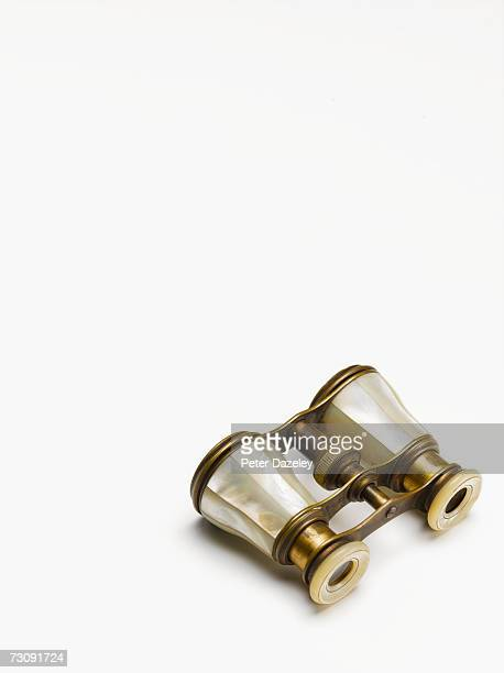 Opera glasses on white background, elevated view