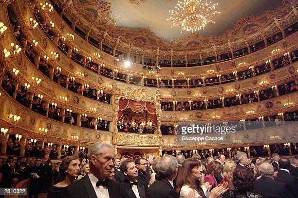 Opera goers attend the reopening of the La Fenice opera house on December 14 2003 in Venice Italy The opera house burned to the ground back in 1996
