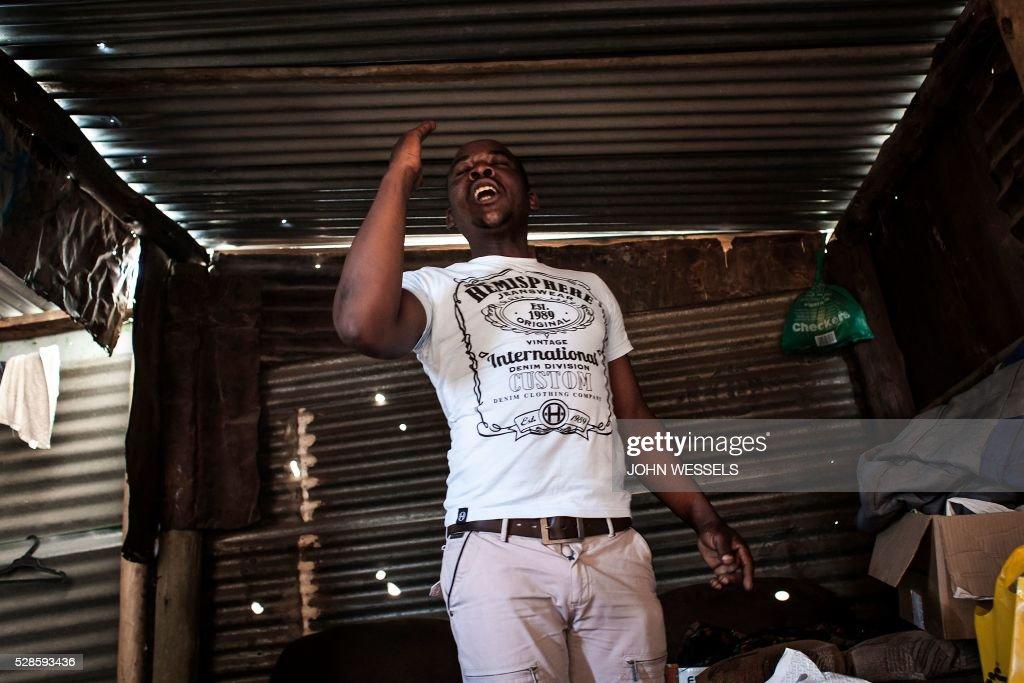 Opera singer Abdias Mkhabela practises his Italian opera singing inside his home in an informal settlement called Bokfontein on April 28 2016 in...