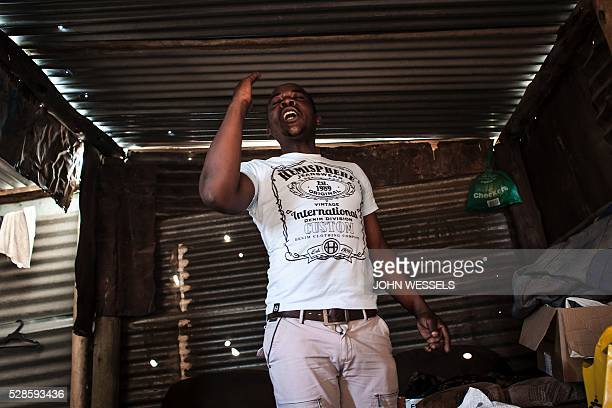 Opera singer Abdias Mkhabela practises his Italian opera singing inside his home in an informal settlement called Bokfontein on April 28 2016 in...