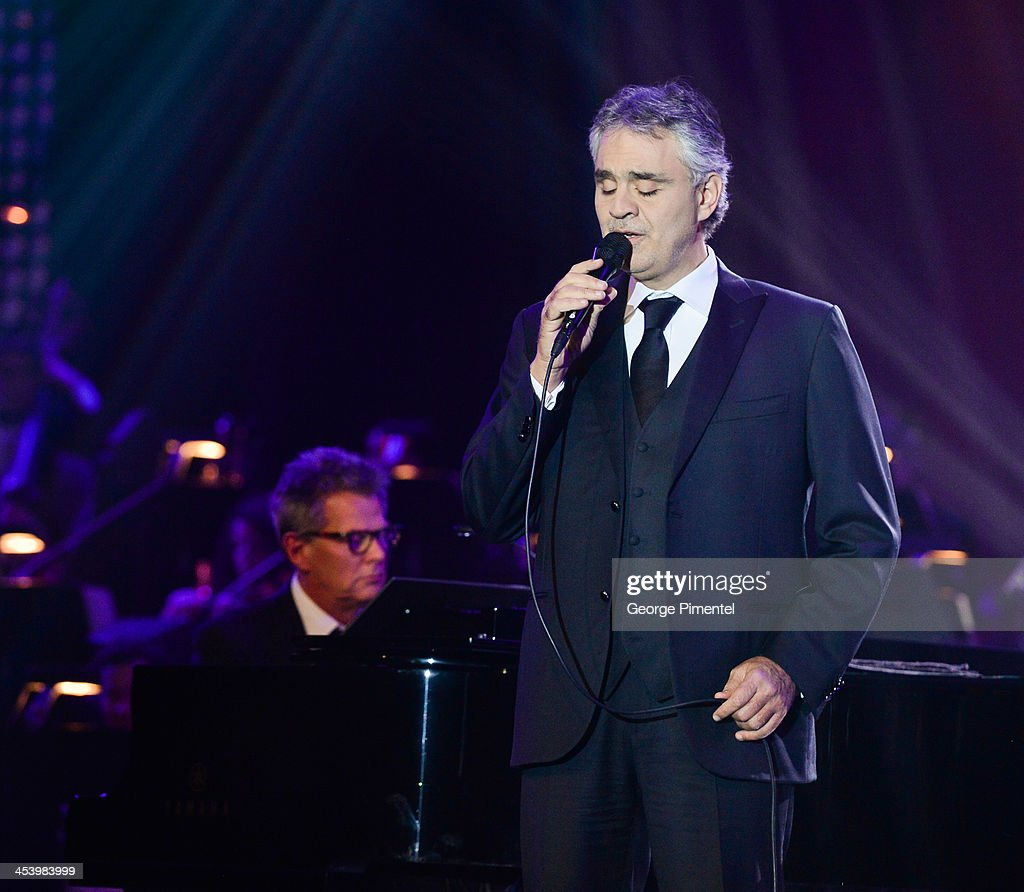 Opera singer <a gi-track='captionPersonalityLinkClicked' href=/galleries/search?phrase=Andrea+Bocelli&family=editorial&specificpeople=211558 ng-click='$event.stopPropagation()'>Andrea Bocelli</a> and producer/composer <a gi-track='captionPersonalityLinkClicked' href=/galleries/search?phrase=David+Foster&family=editorial&specificpeople=210611 ng-click='$event.stopPropagation()'>David Foster</a> perform at the <a gi-track='captionPersonalityLinkClicked' href=/galleries/search?phrase=David+Foster&family=editorial&specificpeople=210611 ng-click='$event.stopPropagation()'>David Foster</a> Foundation Benefit Concert at Allstream Centre on December 5, 2013 in Toronto, Canada.