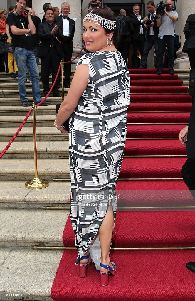 Opera singer <a gi-track='captionPersonalityLinkClicked' href=/galleries/search?phrase=Anna+Netrebko&family=editorial&specificpeople=732328 ng-click='$event.stopPropagation()'>Anna Netrebko</a> attends the 'Guillaume Tell' Opera Premiere at the Opera Festival Opening In Munich on June 28, 2014 in Munich, Germany.