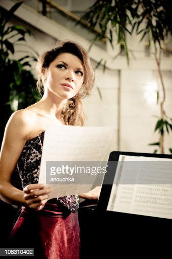 Opera Singer with Music Sheets
