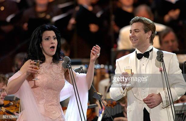Opera Singers Angela Gheorghiu And Roberto Alagna Toast The Queen With Glasses Of Champagne Before Singing An Aria From 'la Traviata' During The...