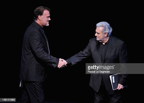 Opera singers Bryn Terfel and Placido Domingo on stage during the Opening Ceremony of the 124th IOC Session prior to the start of the London 2012...