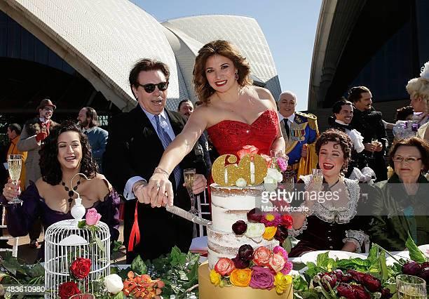 Opera singers cut a birthday cake during Opera Australia's 2016 Season Media Launch and 60th birthday celebration at Sydney Opera House on August 11...