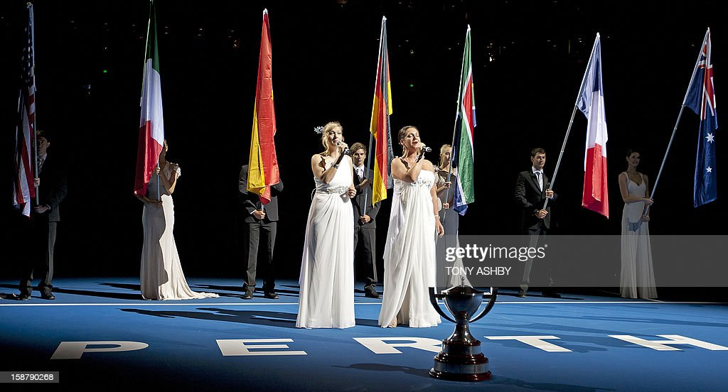 Opera singers Divalicious perform at the opening ceremony on day one of the Hopman Cup tennis tournament in Perth on December 29, 2012. AFP PHOTO / Tony ASHBY USE