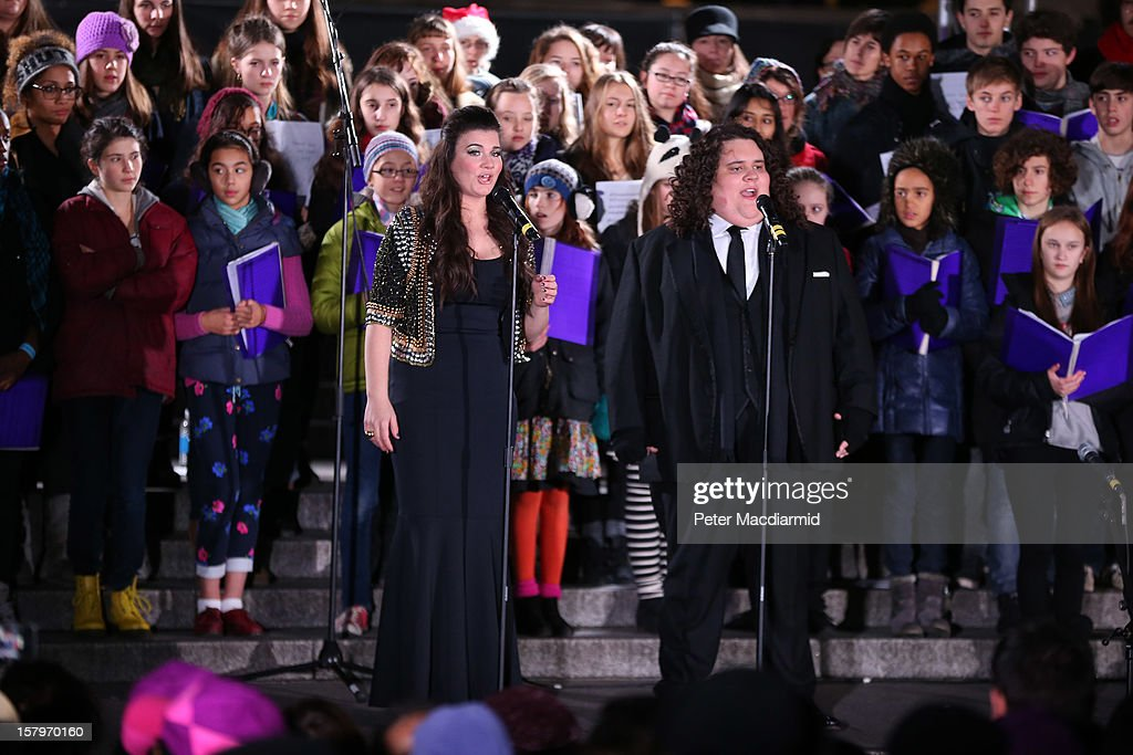 Opera singers Jonathan & Charlotte perform at a Christmas carol concert held in Trafalgar Square on December 8, 2012 in London, England. The concert is being held to thank the London Olympic 2012 volunteers. London Mayor Boris Johnson thanked the 8000 which he said 'proved to be the beating heart of the Games'.