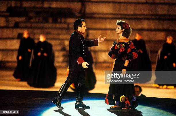 Opera singers José Carreras and Agnes Baltsa sing an aria from Bizet's Carmen at the Arena di Verona in the roles of Don José and Carmen the famous...