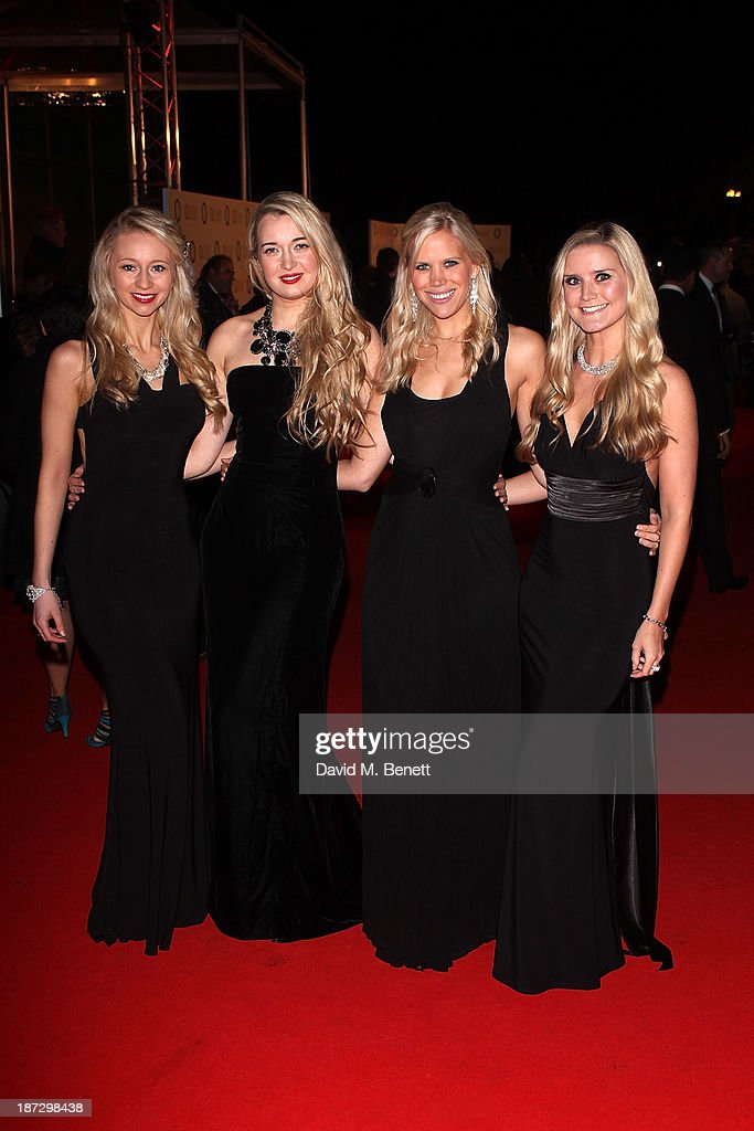 Opera singers 'Passionata' attend the annual Collars and Coats gala ball in aid of Battersea Dogs & Cats home at Battersea Evolution on November 7, 2013 in London, England.