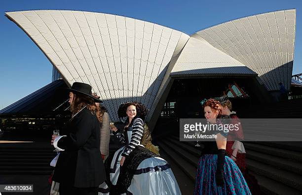 Opera singers walk in front of the Opera House sails during Opera Australia's 2016 Season Media Launch and 60th birthday celebration at Sydney Opera...