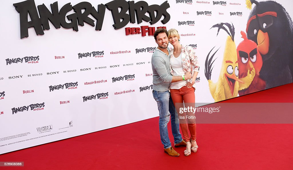 Opera star Tobey Wilson and Sabrina Gehrmann attend the Berlin premiere of the film 'Angry Birds - Der Film' at CineStar on May 1, 2016 in Berlin, Germany.