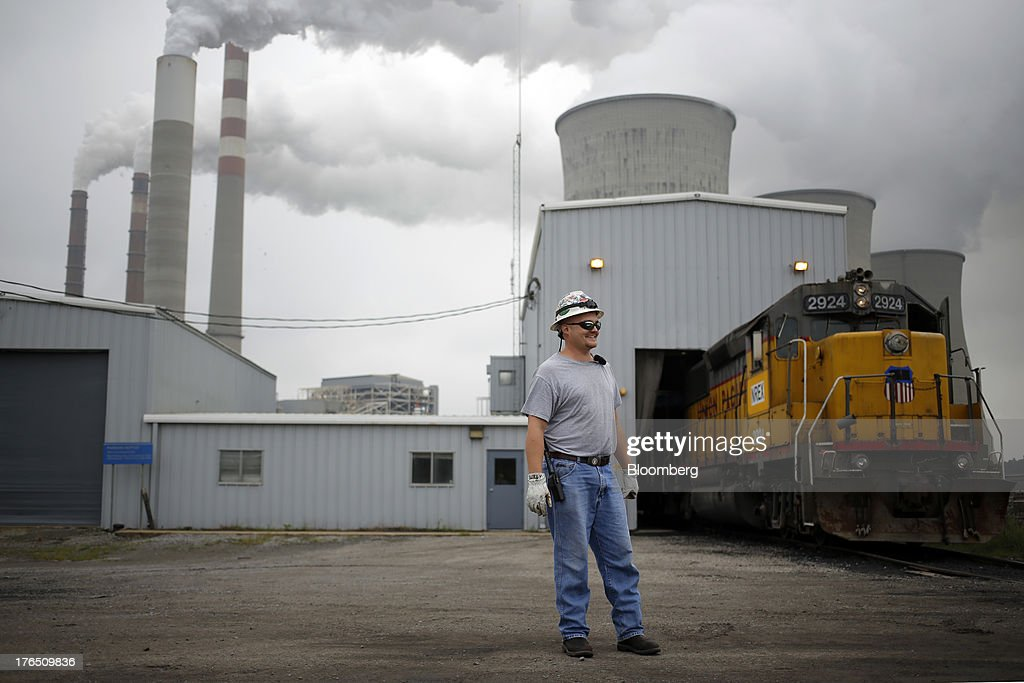 Operating Engineer Michael Burden prepares to move a cut of coal hoppers for unloading at the Tennessee Valley Authority Paradise Fossil Plant in Paradise, Kentucky, U.S., on Tuesday, Aug. 13, 2013. The plant generates and delivers 14 billion kilowatt-hours of coal-fired electricity per year to Western Kentucky and Nashville, Tennessee. Photographer: Luke Sharrett/Bloomberg via Getty Images
