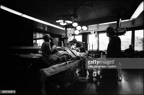 Operating Room With Surgeons Performing Surgery