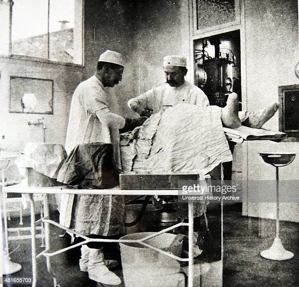 Operating theatre in use by surgeons at a teaching hospital in Paris France 1900