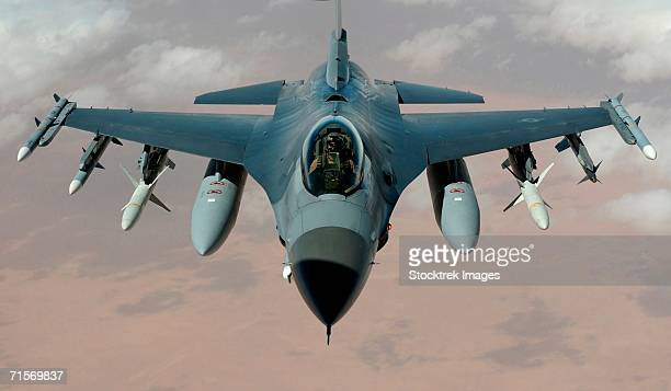 'Operation Iraqi Freedom - An F-16 Fighting Falcon flies a mission in the skies near Iraq on March 22.  The F-16s are from the 35th Fighter Wing Wild Weasels, Misawa Air Base, Japan. '