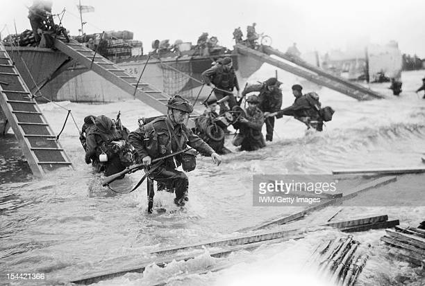 Operation Overlord DDay 6 June 1944 The British 2nd Army Royal Marine Commandos of Headquarters 4th Special Service Brigade making their way from...
