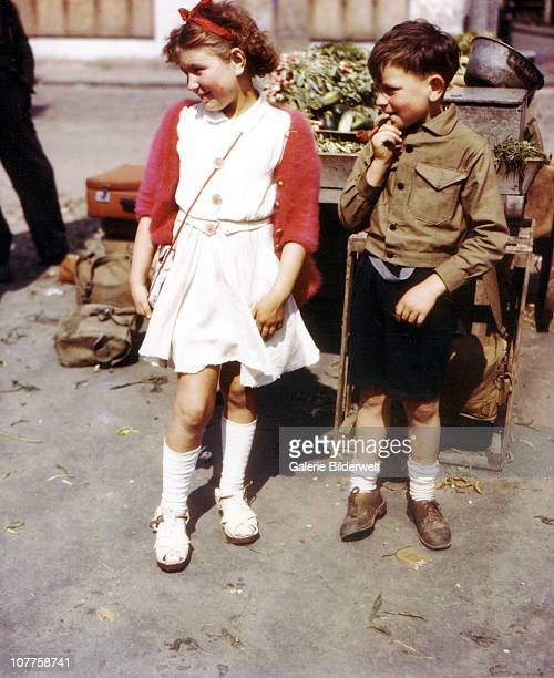 Operation Overlord Normandy A boy and a girl are standing in the market in Cherbourg which has recently been liberated by the United States Army July...