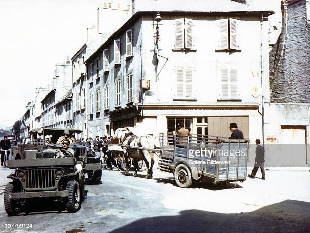 Operation Overlord Normandy A street in Cherbourg which has recently been liberated by the United States Army July 1944 More than 10000 German...