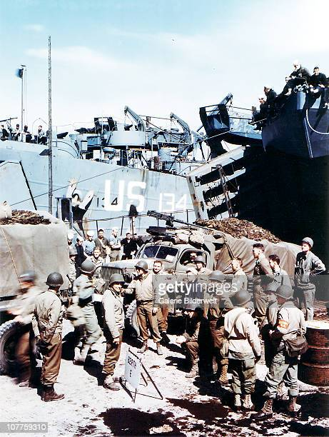 Operation Overlord Normandy A trucks of the 1st Infantry Division of the United States Army are loaded into a Landing Ship Tank in Southern England...