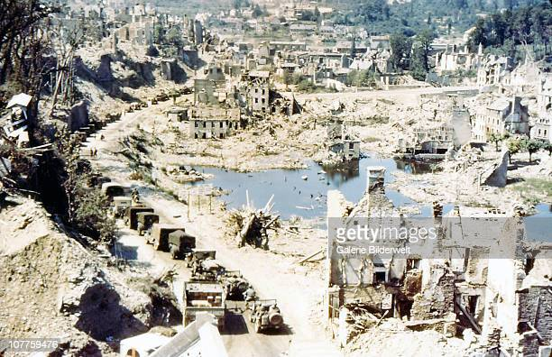 Operation Overlord Normandy Many jeeps and other Unites States Army vehicles are driving through the ruins of SaintLo August 1944 The town was almost...