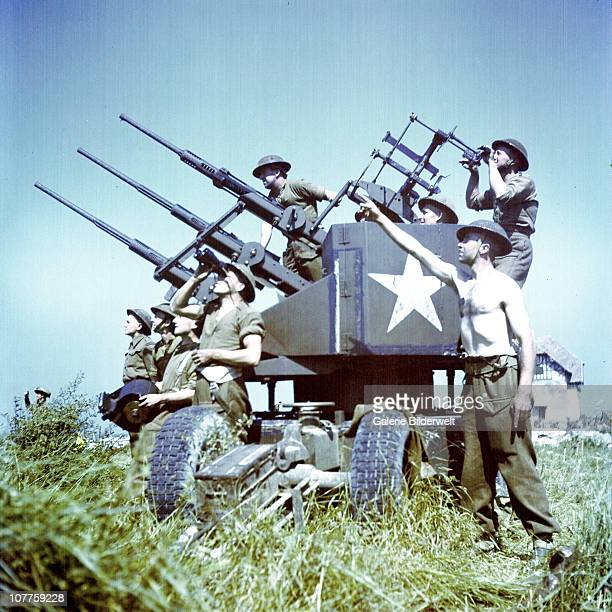 Operation Overlord Normandy Soldiers of the 3rd Canadian Infantry Division have set up antiaircraft guns on Juno Beach where they landed on DDay on...
