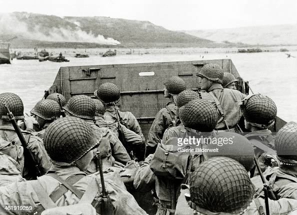US soldiers watch the Normandy coast from a Landing Craft Vehicle Personnel heading towards Omaha Beach Easy Red sector 6th June 1944 Several...