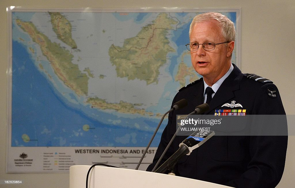 Operation Sovereign Borders Acting Commander Air Marshal Mark Binskin speaks during a press conference with Australian Immigration Minister Scott Morrison in Sydney on September 30, 2013, where Morrison rejected claims that Australian authorities took too long to respond to distress calls from an asylum seeker boat which went down off the coast of Java, killing at least 31 people. Morrison held the second of his weekly briefings on asylum seeker matters as Australian Prime Minister Tony Abbott heads to Jakarta for his first international meeting as Prime Minister, where the boat people issue will high on the agenda of bilateral discussions with his Indonesian counterpart, president Susilo Bambang Yudhoyono. AFP PHOTO/William WEST