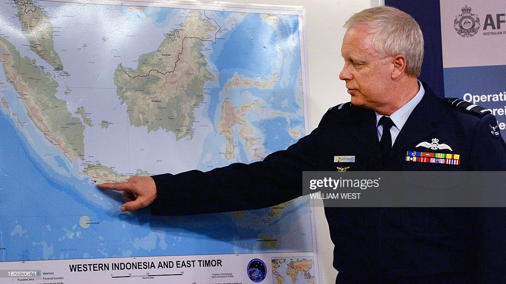 Operation Sovereign Borders Acting Commander Air Marshal Mark Binskin points to a map during a press conference with Australian Immigration Minister Scott Morrison in Sydney on September 30, 2013, where Morrison rejected claims that Australian authorities took too long to respond to distress calls from an asylum seeker boat which went down off the coast of Java, killing at least 31 people. Morrison held the second of his weekly briefings on asylum seeker matters as Australian Prime Minister Tony Abbott heads to Jakarta for his first international meeting as Prime Minister, where the boat people issue will high on the agenda of bilateral discussions with his Indonesian counterpart, president Susilo Bambang Yudhoyono. AFP PHOTO/William WEST
