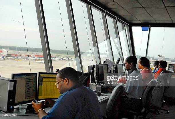 Operations specialists monitor flights from the concourse D control tower at HartsfieldJackson International Airport in Atlanta Georgia US on Tuesday...