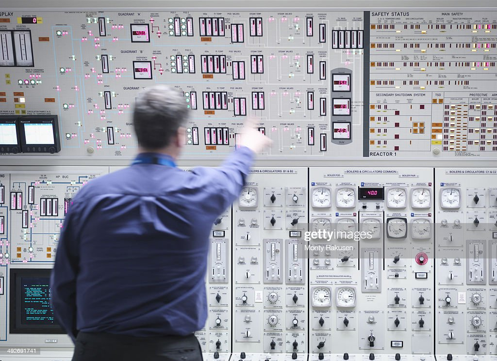 Operator adjusting controls in nuclear power station control room simulator
