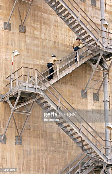 Operator Maurice Jones and supervisor Chad Horton climb stairs on the side of a 160 foot tank at the Freeport LNG facility in Quintana Texas US on...
