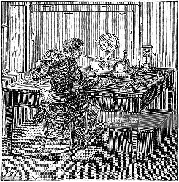 Operator receiving a message in Morse code on an electric printing telegraph 1887 In the box under the table are the wet cells supplying electricity