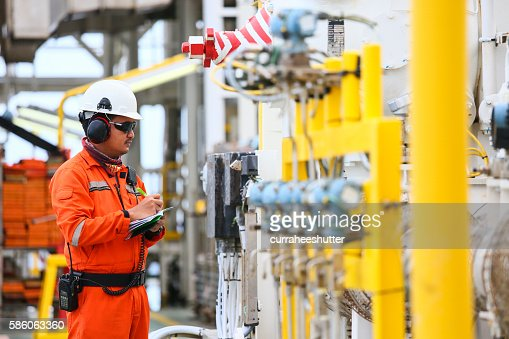 operator recording operation of oil and gas process : Stock Photo