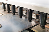 Operator working cut and bending metal sheet by high precision metal sheet bending machine, cnc control metal sheet bending machine in factory.