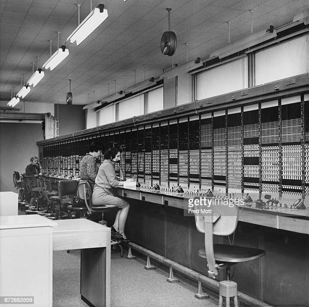Operators at the automatic telephone exchange in the telecommunications rooms at the New Scotland Yard building on Broadway Victoria London 9th...