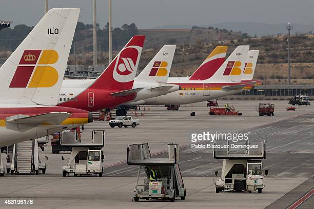 Operators drive mobile escalators at the planes parking area in Madrid Barajas Adolfo Suarez airport which is operated by group Aena on February 11...