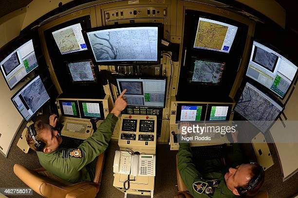 Operators FLT LT Tom Maddock and Master Rear Crew David Gaul sit in one of the Ground Control Stations at RAF Waddington on January 15 2014 in...